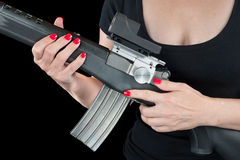Woman holding assault rifle Royalty Free Stock Photos