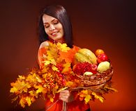 Woman holding autumn basket. Royalty Free Stock Photography