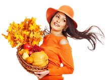 Woman holding autumn basket. Royalty Free Stock Photo