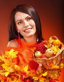 Woman holding autumn basket. Stock Images