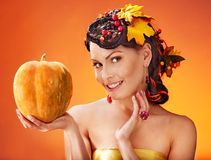 Woman holding autumn basket. Royalty Free Stock Images