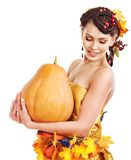Woman holding autumn fruit. Stock Photos