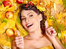 Woman holding autumn fruit. Royalty Free Stock Photos