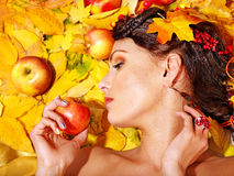 Woman holding autumn fruit. Stock Photo