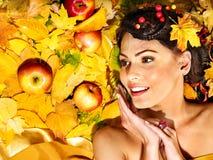 Woman holding autumn fruit. Royalty Free Stock Photo