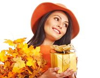 Woman holding autumn gift box . Royalty Free Stock Images