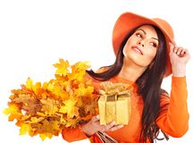 Woman holding autumn gift box . Royalty Free Stock Image