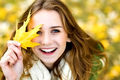 Woman holding autumn leaf Royalty Free Stock Photography