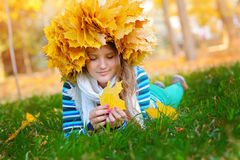 Woman holding autumn leaf Royalty Free Stock Photos