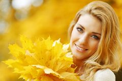Woman holding autumn leaves Stock Photos