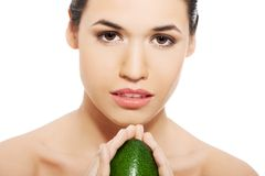Woman holding avocado Royalty Free Stock Images