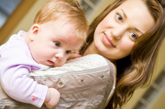 Woman holding baby. Portrait of a young woman holding a baby girl Stock Photography