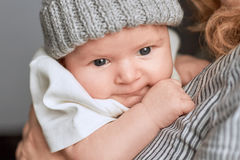 Woman holding baby, close up. Face of an infant Royalty Free Stock Photo
