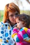 Woman holding baby girl Stock Photo