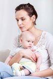 Woman holding baby in hands Royalty Free Stock Images