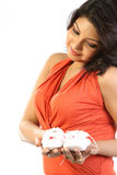 Woman holding baby shoes Royalty Free Stock Photo