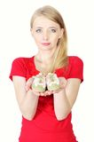 Woman holding baby shoes showing she is pregnant. Isolated on white royalty free stock images