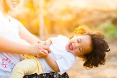 Woman Holding Baby Smiling stock image