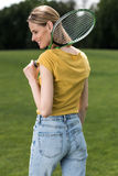 Woman holding badminton racquet and looking away Royalty Free Stock Images