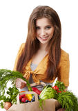 Woman holding a bag full of healthy food. Royalty Free Stock Photos