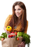 Woman holding a bag full of healthy food. Royalty Free Stock Photography