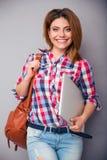 Woman holding bag and laptop Stock Photos