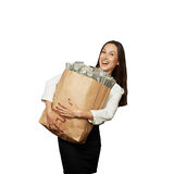 Woman holding bag with money Stock Photography