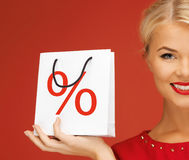 Woman holding bag with percent sign Royalty Free Stock Photography