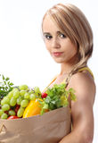 Woman holding bag with vegetables Stock Photography