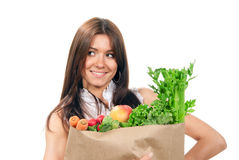 Woman holding bags with food ingredients Stock Photography