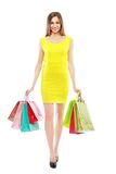 Woman holding bags royalty free stock photos