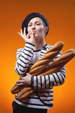 Woman holding baguettes and shows that taste is delicious Royalty Free Stock Photography