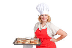 Woman holding a bake sheet Royalty Free Stock Images