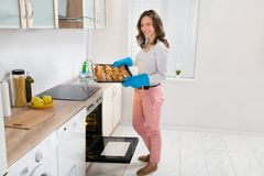 Woman Holding Baking Tray With Bread Stock Image