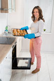 Woman Holding Baking Tray With Bread Stock Photography
