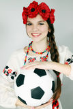 Woman holding a ball Stock Images