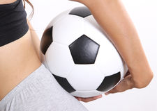 Woman holding ball. Closeup image of woman holding a football on her hand in the back stock photo