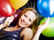 Woman holding ballons and celebrating Royalty Free Stock Image