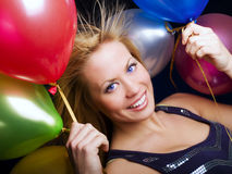 Woman holding ballons and celebrating Stock Images
