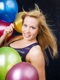 Woman holding ballons and celebrating Royalty Free Stock Photography