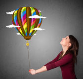 Woman holding a balloon drawing Stock Photography