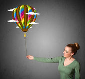 Woman holding a balloon drawing Royalty Free Stock Image