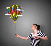 Woman holding a balloon drawing Royalty Free Stock Photos
