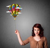 Woman holding a balloon drawing Stock Photos