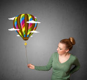 Woman holding a balloon drawing Stock Photo