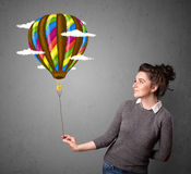Woman holding a balloon drawing Royalty Free Stock Photography
