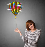 Woman holding a balloon drawing Stock Photos