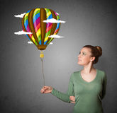 Woman holding a balloon drawing Royalty Free Stock Images