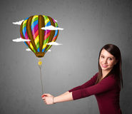 Woman holding a balloon drawing Royalty Free Stock Photo