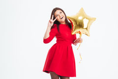 Woman holding balloon and showing two fingers sign Royalty Free Stock Photography